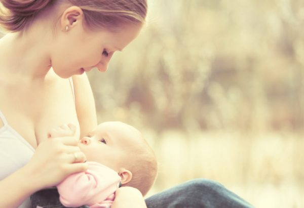 new mom breastfeeding baby