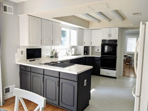 Kitchen cabinets and countertops are painted with chalk paint