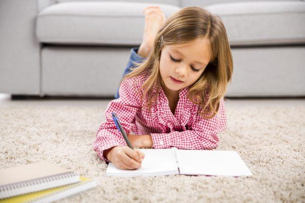 Little girl making homework at home