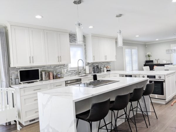 beautiful recently renovated kitchen with best kitchen features like mid back non-turning bar stools
