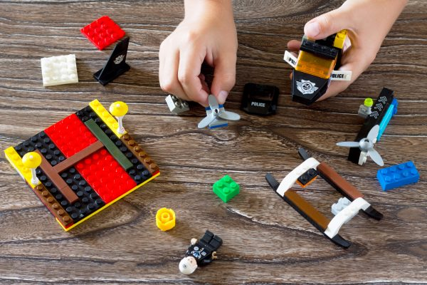 kid playing with legos and making a lego stop motion video