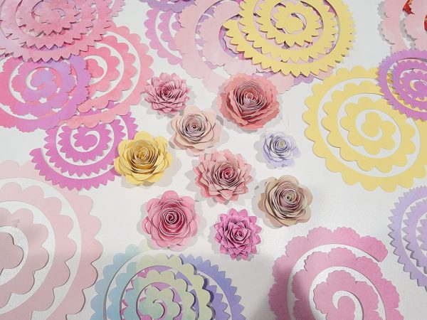 cricut cut paper flowers on a table