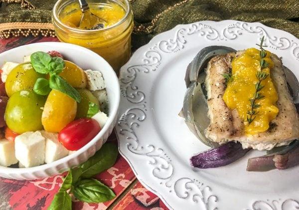 mahi mahi with mango on plates
