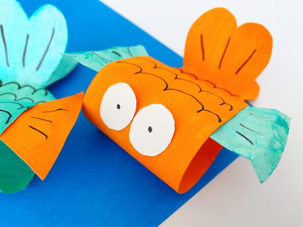 orange fish made out of paper plate using this fish craft for toddlers project
