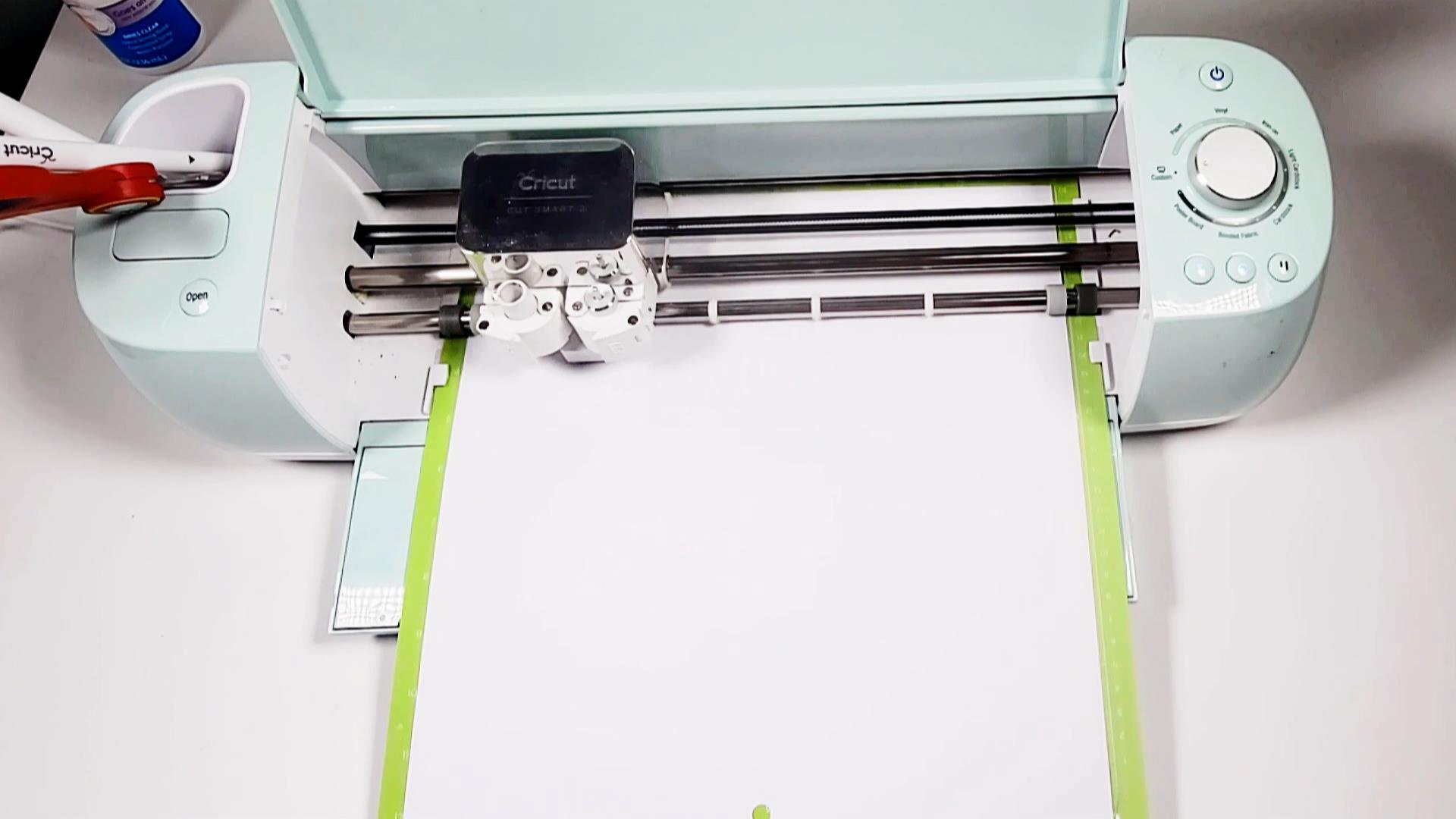 cricut machine cutting cardstock for a layered paper shadow box for father's day