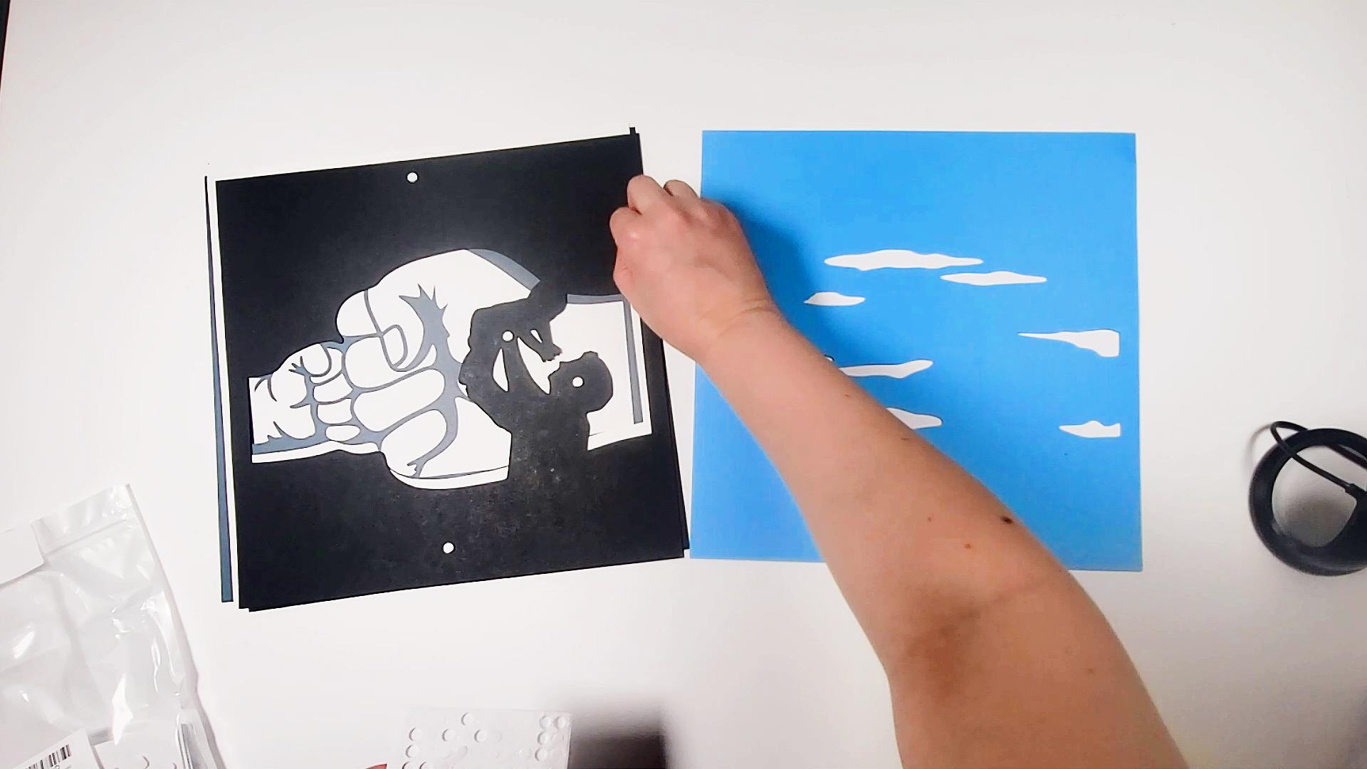 how to use foam glue dots to assemble a layered paper shadow box for father's day