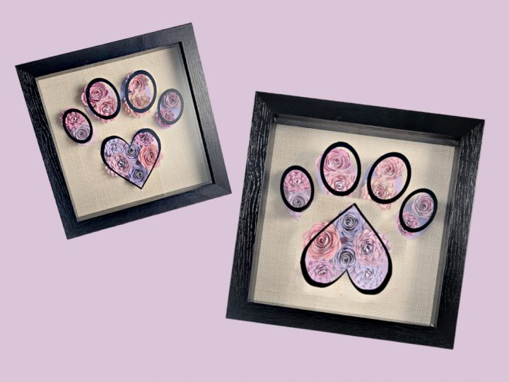 two shadow boxes with paper flowers in the shape of a paw print made with a cricut pet project tutorial