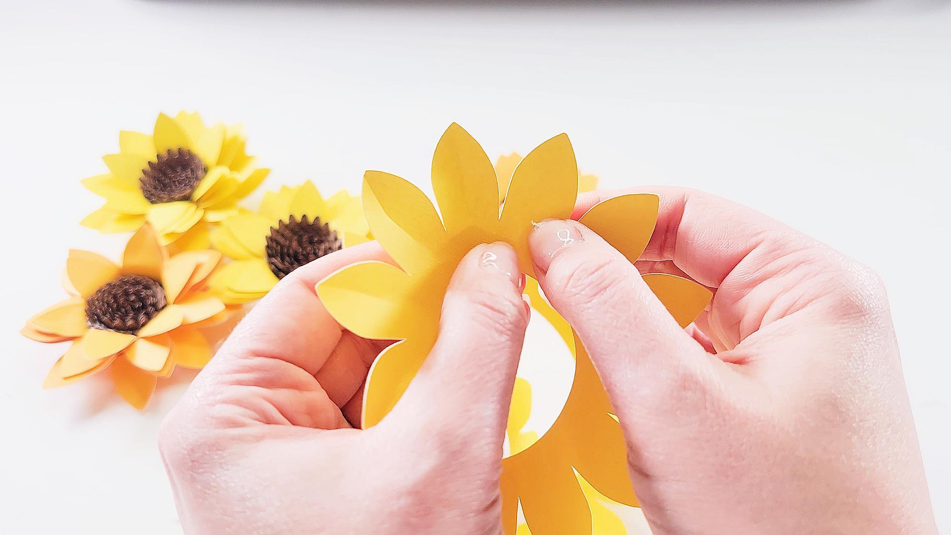 scoring the petals of a sunflower paper flower