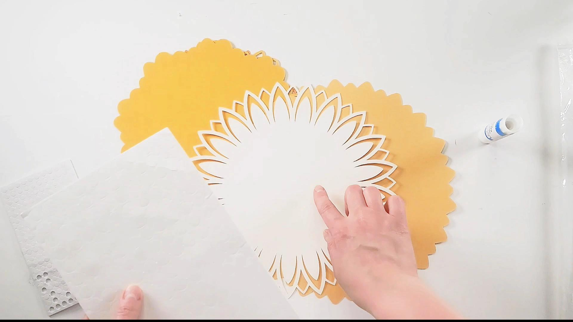 Adding foam dots to the layers of your 3d mandala