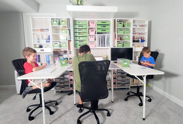 photo of 3 kids sitting at a Createroom Dreambox with 2 side tables attached