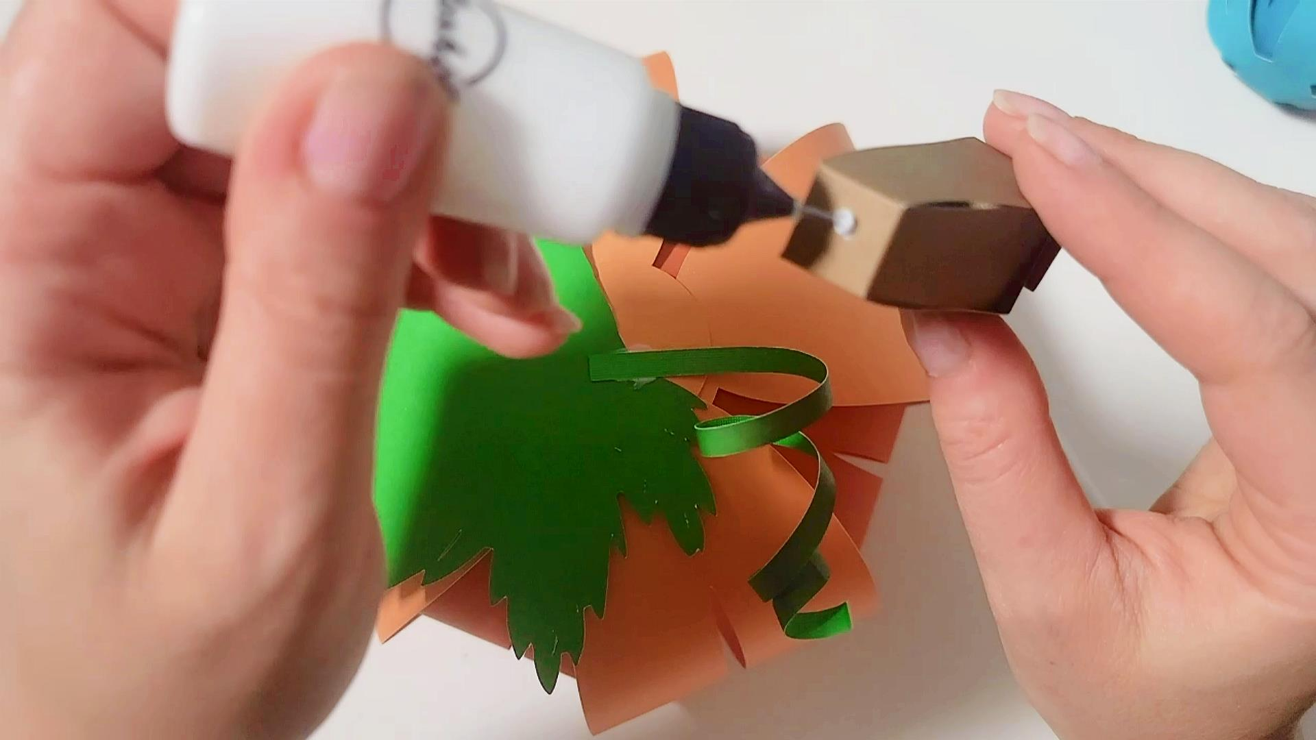 Gluing stem to finished DIY paper pumpkin craft