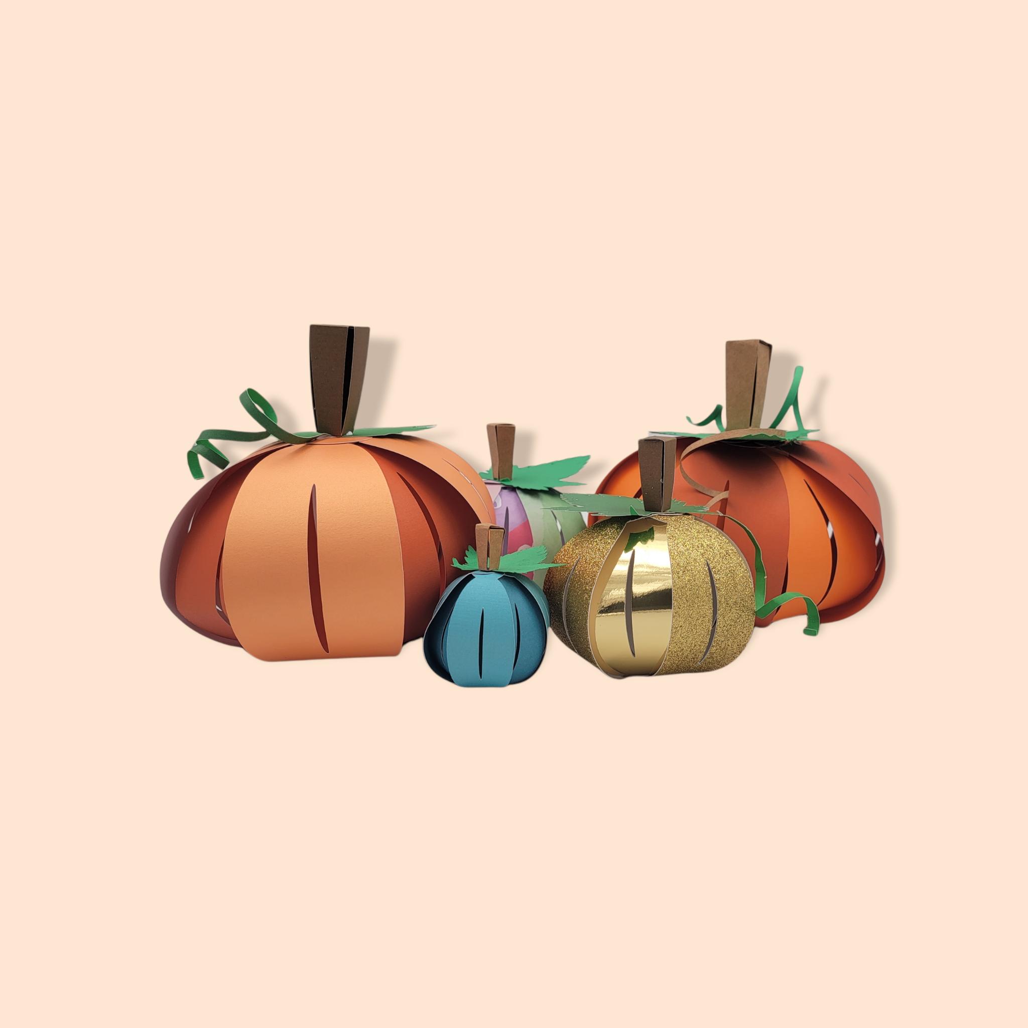 pumpkins made with this 3D paper pumpkin craft template